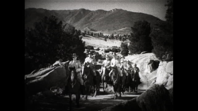 """beginning of a western movie with the title card """"to protect a shipment of government gold, troops are on their way to escort the wagon train""""; title... - wild west stock videos & royalty-free footage"""