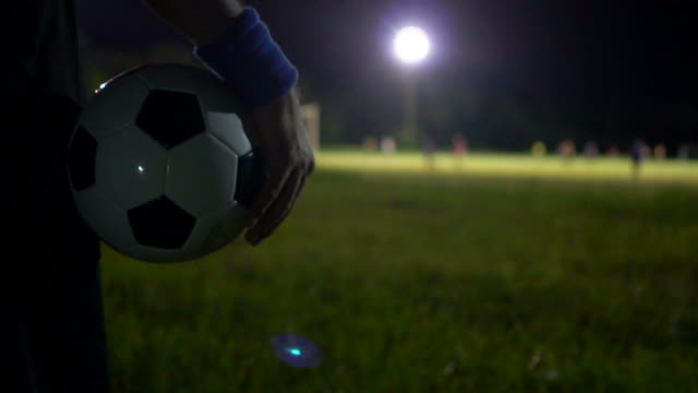 beginning of the soccer match with referee blowing whistle. - fischietto video stock e b–roll