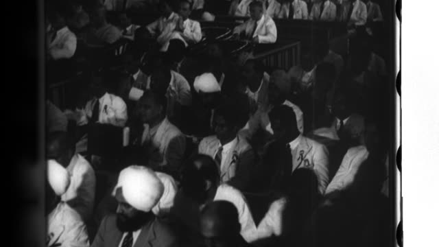 Behari Bose addresses the Indian Independence League meeting in Bangkok Thailand hometown representatives and reporters attend the meeting Indians...