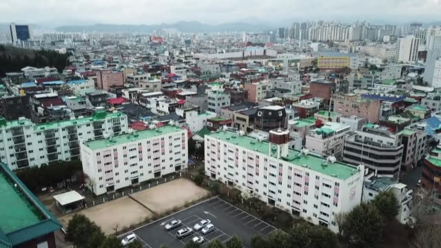 behind a closed metal gate and a sign barring entry to outsiders dozens of religious sect members are quarantined in a social housing complex in... - korea stock videos & royalty-free footage