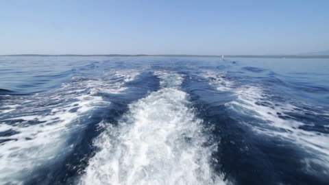 behind a motor boat. - water surface stock videos & royalty-free footage