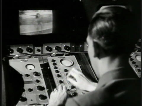 man operating camera control board watching monitor of woman performing modern dance on set in home family mother father w/ cigarette in mouth son... - filmset stock-videos und b-roll-filmmaterial