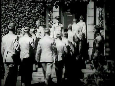 behind naval cadets walking into building. three cadets talking. group of naval cadets walking together on campus. war effort: scrap harvest day: boy... - time of day stock videos & royalty-free footage