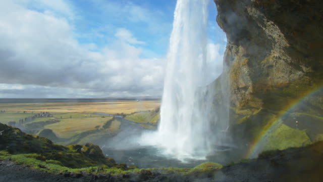 behind seljalandfoss waterfall, iceland - seljalandsfoss waterfall stock videos and b-roll footage