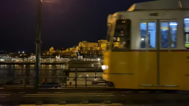 behind the famous budapest tram line is the buda castle - royal palace of buda stock videos & royalty-free footage