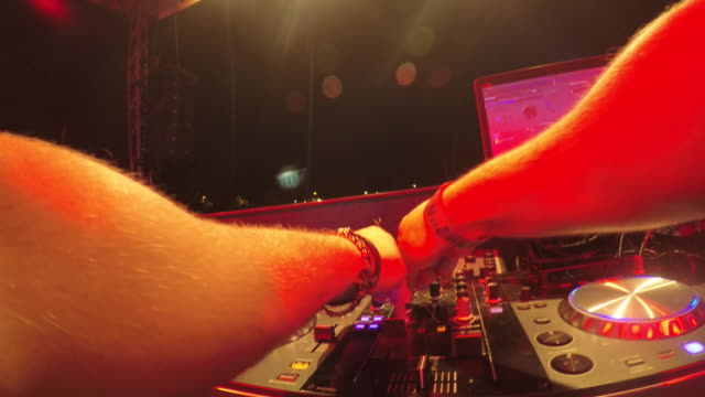 pov dj behind the mixing table - dj stock videos & royalty-free footage