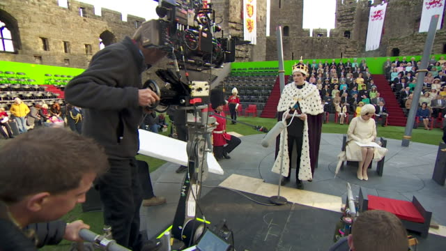 behind the scenes at filming of the crown, featuring prince charles investiture, at caernarfon castle - crown stock videos & royalty-free footage