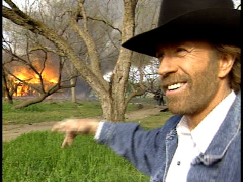 behind the scenes of walker, texas ranger including footage of a staged explosion and an interview with chuck norris. - stunt person stock videos & royalty-free footage