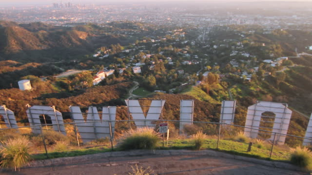 ZI MS behind View of Hollywood sign / Los Angeles, California
