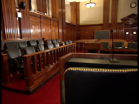 empty courtroom, jury box of frame & gallery bg, back of empty witness stand fg. testify, call witness, trial, law, truth, swearing oath, courthouse. - court room stock videos & royalty-free footage