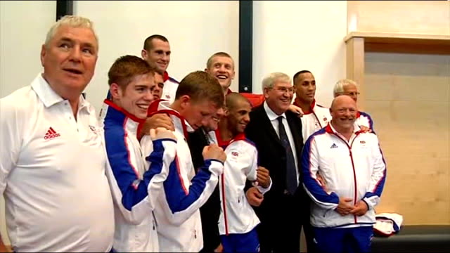 BOXING British Olympic Boxing media day British Boxing team poses for photocall Khan talking to reporters Khan along Khan posing with British Boxing...