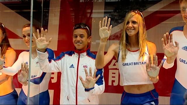 British kit revealed ENGLAND London EXT British Olympic athletes wearing Adidasdesigned British Olympic kit posing in shop window British athletes...