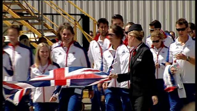 beijing 2008 olympic games: british rowing team departing from airport; england: london: heathrow airport: ext photographers on tarmac / slogan on... - 2008年北京夏季オリンピック点の映像素材/bロール
