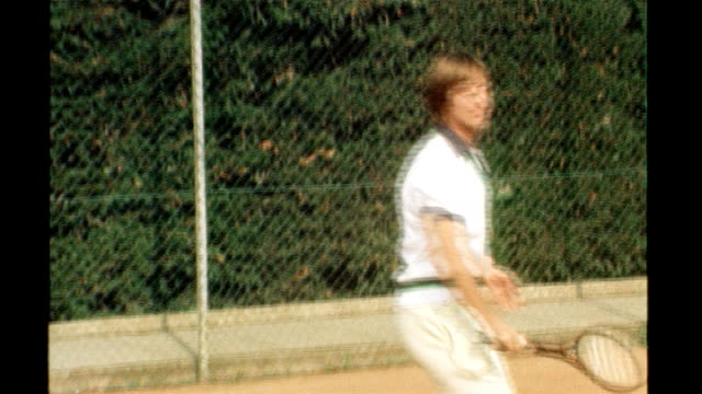 doubleamputee athlete wins right to compete tx london david lloyd playing with doublestringed tennis racquet with opponent john barrett close up of... - tennis racket stock videos & royalty-free footage