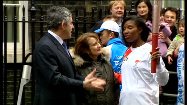 London torch procession disrupted by Tibet protesters Downing Street Denise Lewis holding torch as talking to Gordon Brown MP and Tessa Jowell MP
