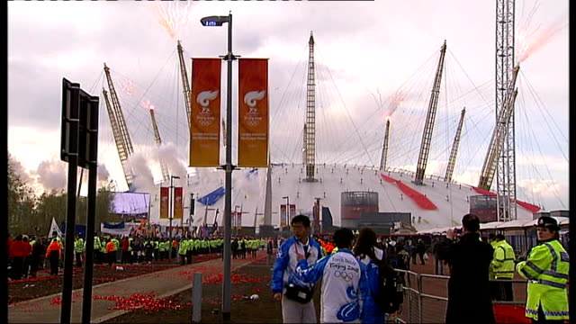 London torch procession disrupted by Tibet protesters Millennium Dome with police officers and torch attendants in foreground