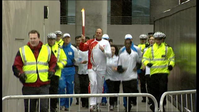 London torch procession disrupted by Tibet protesters Wembley Stadium Steve Redgrave running with torch out of Wembley Stadium