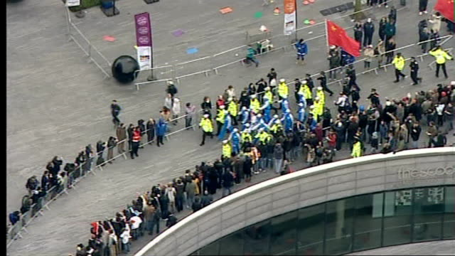 beijing 2008 olympic games: london torch procession disrupted by tibet protesters: air views of the olympic torch relay and protests; torch passing... - flaming torch stock videos & royalty-free footage