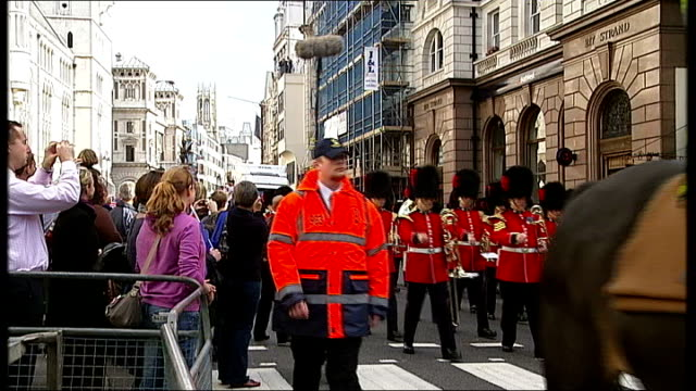 london victory parade compilation mounted police and marching band along past crowds / woman along as waving flag next to paralympic athlete in... - olympic medal stock videos & royalty-free footage