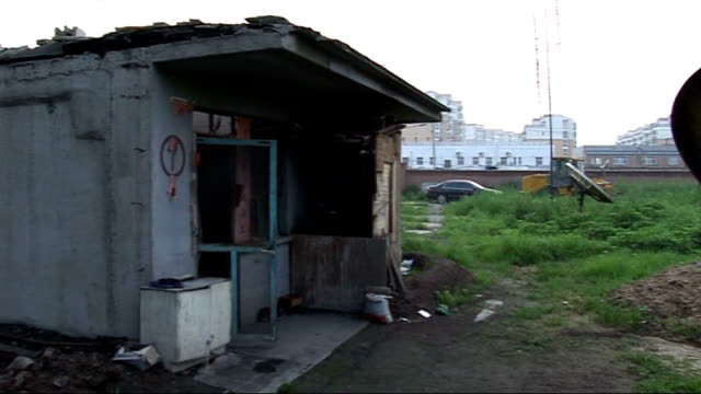 man evicted from house to make way for olympics ext various general views of shack / yu shi liu bending as filling kettle from water pipe / more of... - 立ち退き点の映像素材/bロール
