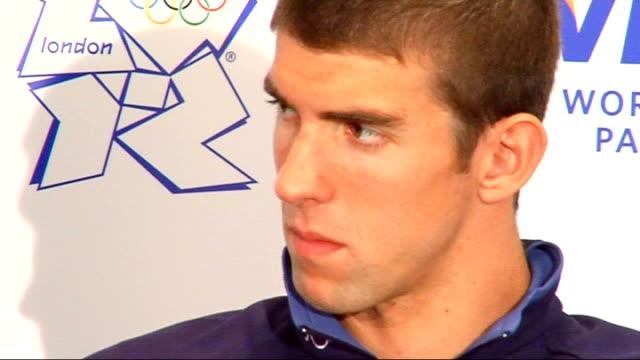 beijing 2008 olympic games: michael phelps in london; more of phelps sitting in on visa press conference - 2008年北京夏季オリンピック点の映像素材/bロール