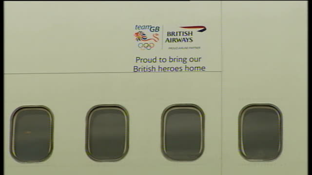Team GB return to Britain arrival at Heathrow Airport Security on tarmac by plane / Team GB and British Airways logos on body of plane with slogan...