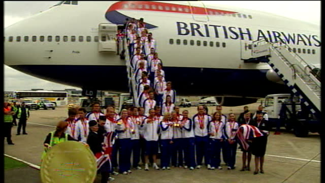 beijing 2008 olympic games: team gb return to britain: arrival at heathrow airport; silver and bronze medal winners joining others for photocall on... - hoy stock videos & royalty-free footage