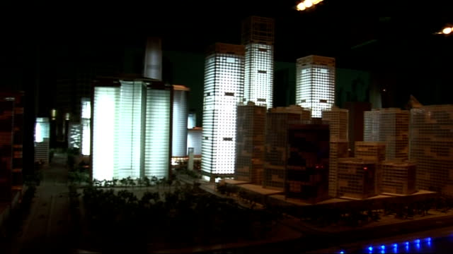 beijing 2008 olympic games: traffic congestion / model of beijing / traffic / views of bird's nest stadium; various of illuminated skyscrapers in... - bird's nest stock videos & royalty-free footage