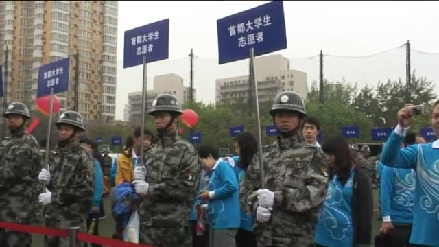 beijing, 25 april .- a virtual army of adolescents accompanied by chinese troops march to a beijing high school to witness the government's promised... - witness stock videos & royalty-free footage