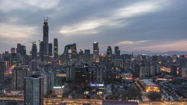 t/l ws ha zi beijing central business district panorama, day to night transition / beijing, china - pechino video stock e b–roll