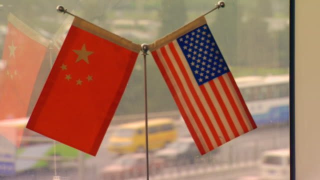 beijing, chinachina and american flag - chinese flag stock videos and b-roll footage