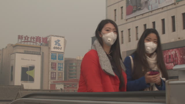beijing city streets, traffic, buildings - pollution mask stock videos & royalty-free footage