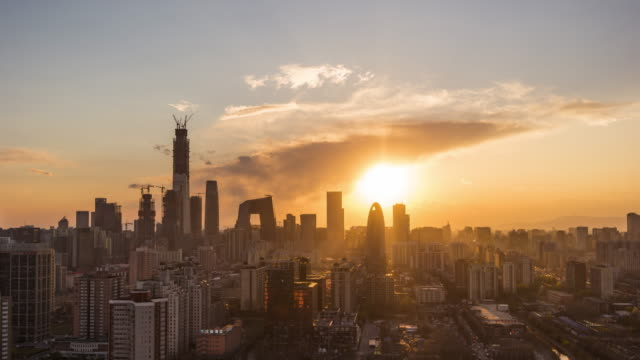 t/l ws ha beijing dramatic urban skyline changing in sunshine / beijing, china - pechino video stock e b–roll