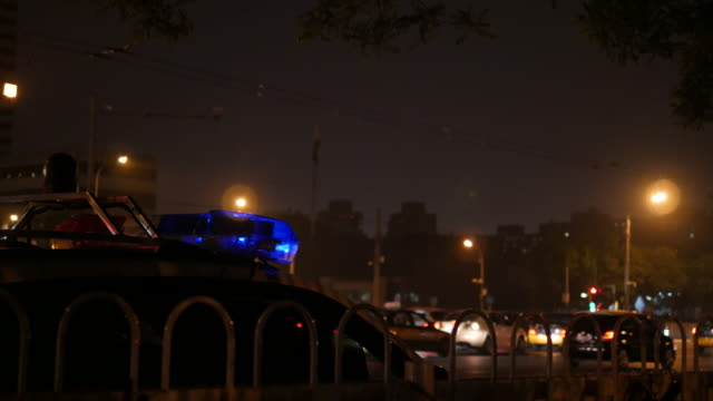 beijing evening traffic and police car - police car stock videos & royalty-free footage