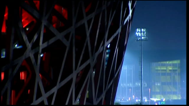 various good shots of beijing national stadium , illuminated blue and red - bird's nest stock videos & royalty-free footage