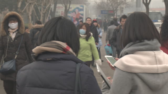 beijing in the smog - smog video stock e b–roll
