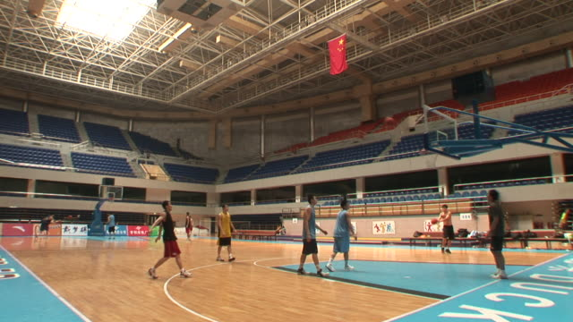 ws, beijing jinyu ducks basketball players shooting hoops in stadium, beijing, china - basketball ball stock videos & royalty-free footage
