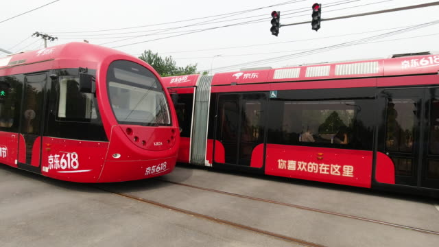beijing modern tram xijiao line,china. - tram stock-videos und b-roll-filmmaterial