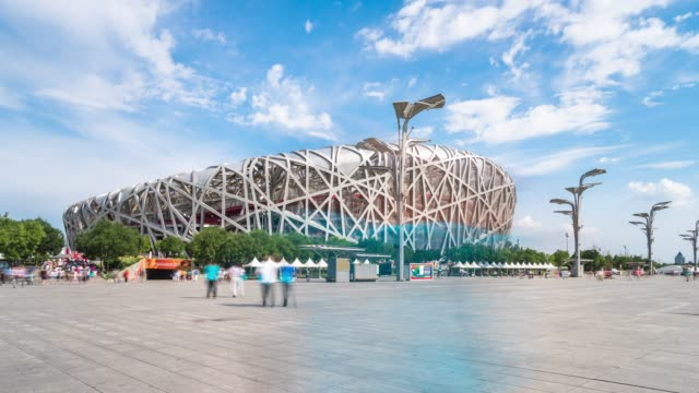beijing nest stadium and busy people on square. timelapse 4k - beijing stock videos & royalty-free footage