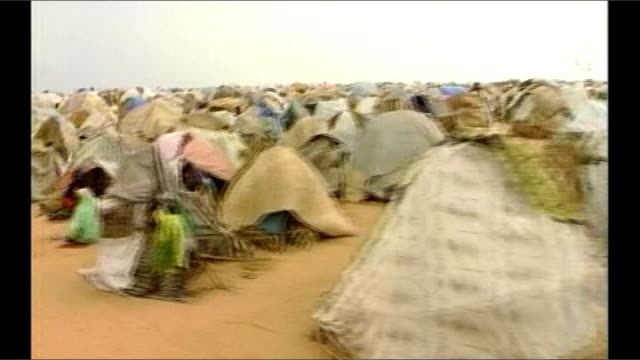 Steven Spielberg resigns as artistic adviser 2004 SUDAN Darfur Juninyah EXT Refugee camps in Darfur
