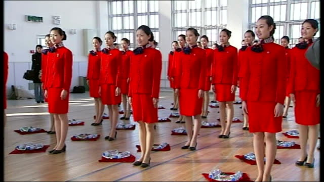 Steven Spielberg resigns as artistic adviser CHINA China 2008 Olympics female hostesses and medal presenters demonstrating medal 'presentation...