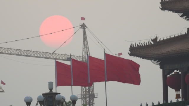 beijing red flag and tiananmen square at sunset - chinese flag stock videos and b-roll footage
