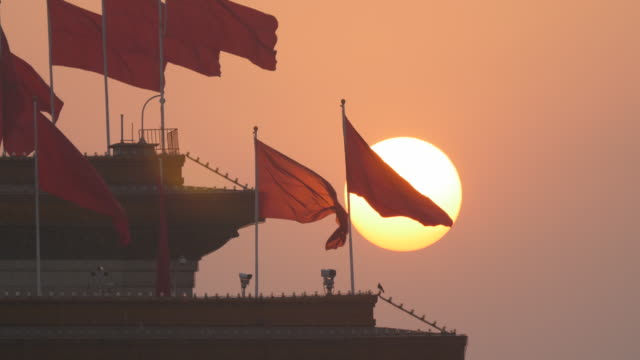 beijing red flag and tiananmen square at sunset - tiananmen square stock videos and b-roll footage