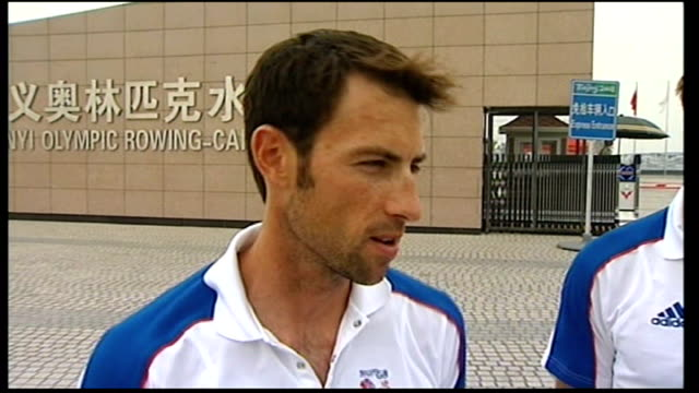vídeos de stock, filmes e b-roll de shunyi olympic rowing-canoeing park: ext reporter with lightweight rowers, mark hunter and zac purchase mark hunter interview sot - saying he did his... - lightweight
