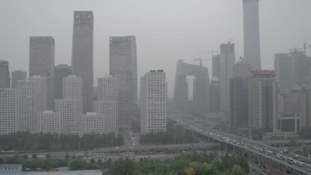 beijing urban skyline in air pollution - beijing stock videos & royalty-free footage
