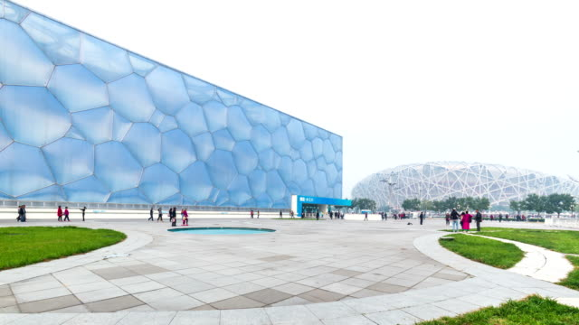 beijing water cubic stadium with bird nest stadium under haze pollution - bird's nest stock videos & royalty-free footage
