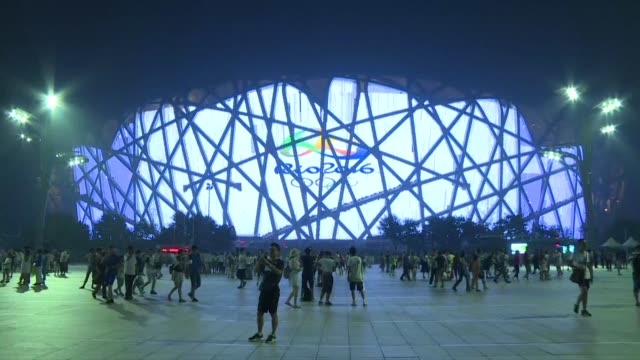 Beijing's iconic Bird's Nest stadium is lit up in Rio colours ahead of the official opening ceremony of the 2016 Games