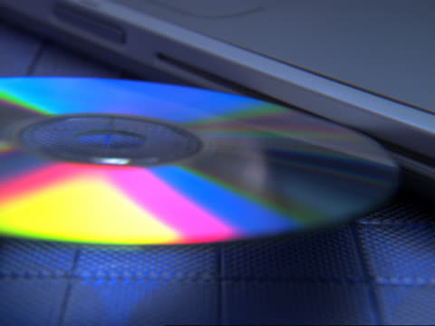 cd-rom being inserted in a laptop - cd rom stock videos & royalty-free footage