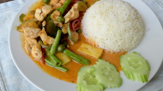Being serve dish of fried chicken with curry souce and vegetables on rice