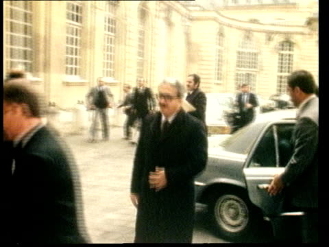 backgrounder 2031981/ france paris tarek aziz from car and into elysee palace aziz up steps and into building past guard of honour pan - beirut stock videos & royalty-free footage